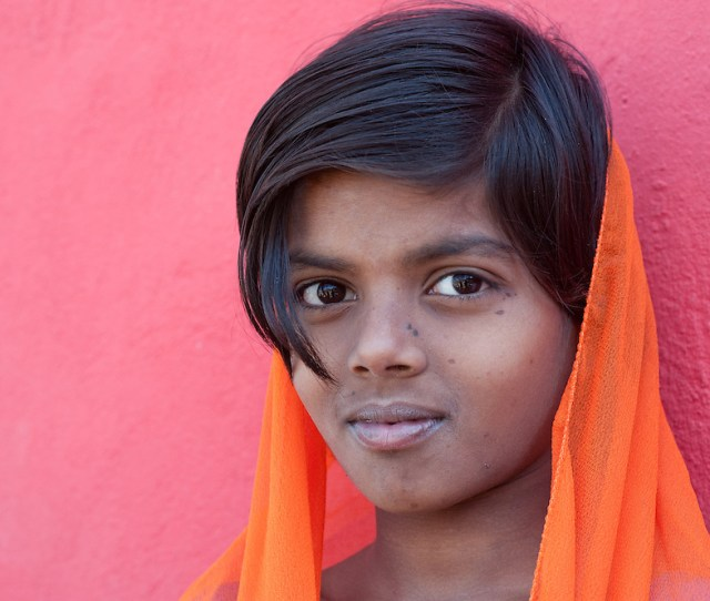 Portrait Of A Young Indian Girl Wearing An Orange Dupatta Headscarf India