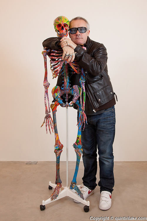 Damien Hirst Portrait with his artwork St Elmos Fire  Quintin Lake Photography