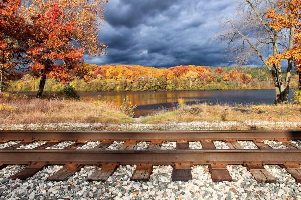 train tracks and fall foliage