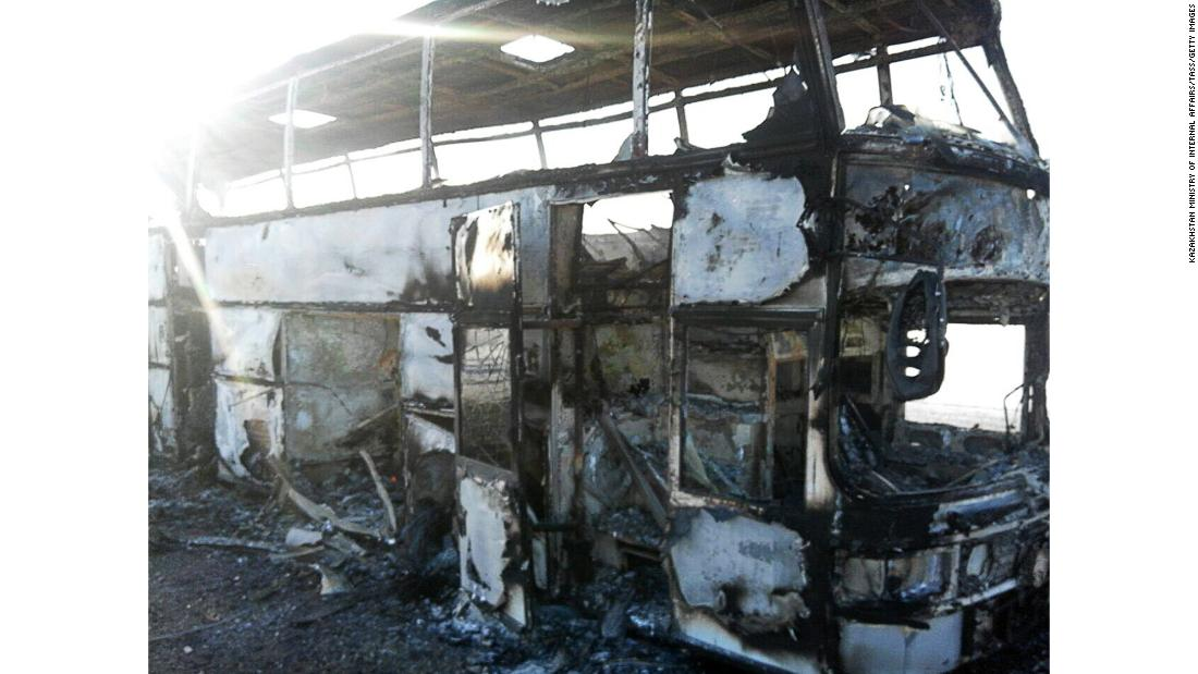 The charred remains of the bus on Thursday.