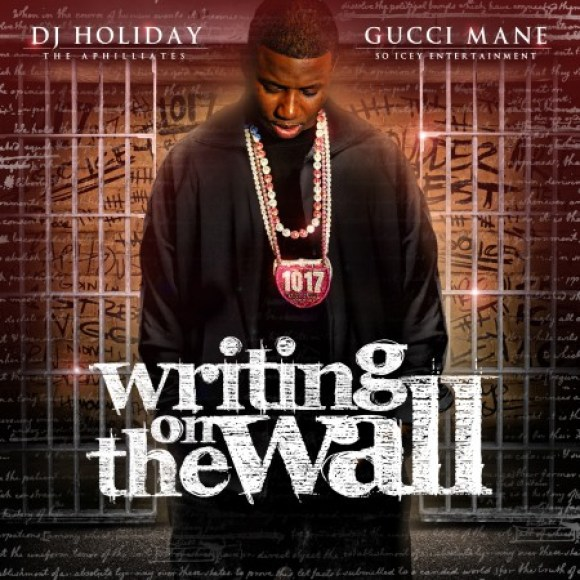gucci mane writing on the wall