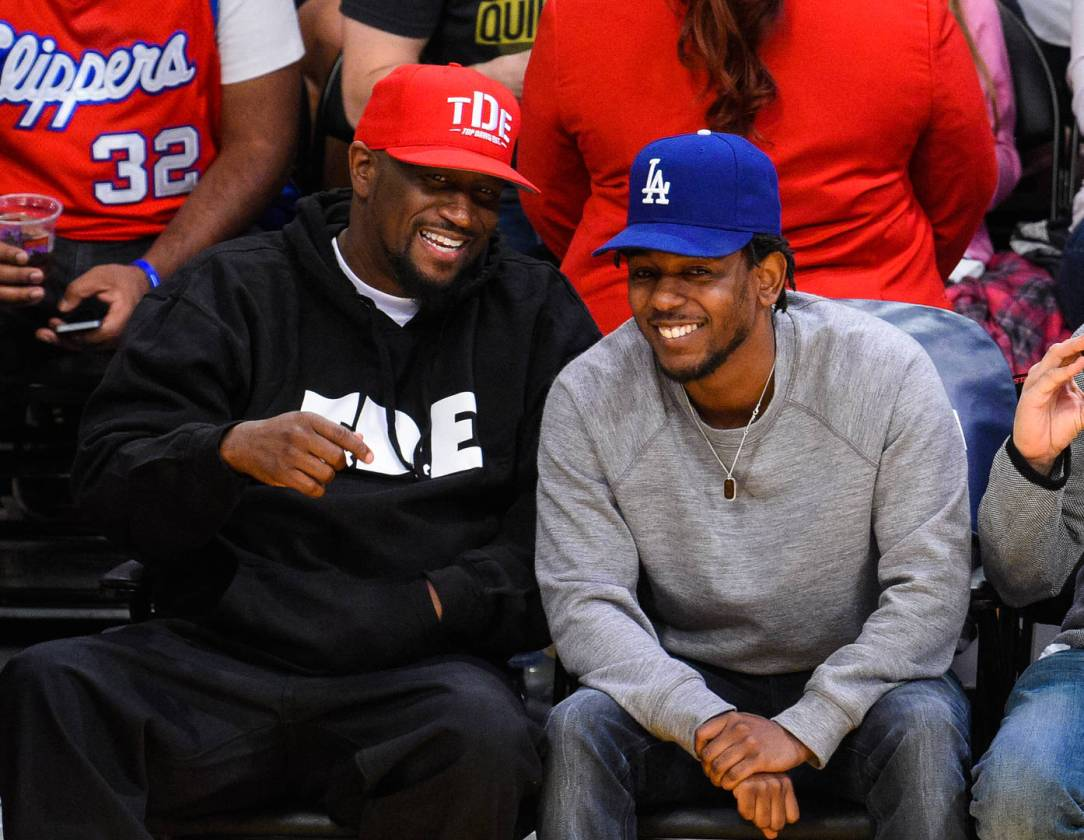 Anthony Tiffith (L) and Kendrick Lamar attend a basketball game between the Los Angeles Clippers and the Los Angeles Lakers at Staples Center on April 5, 2015 in Los Angeles, California.