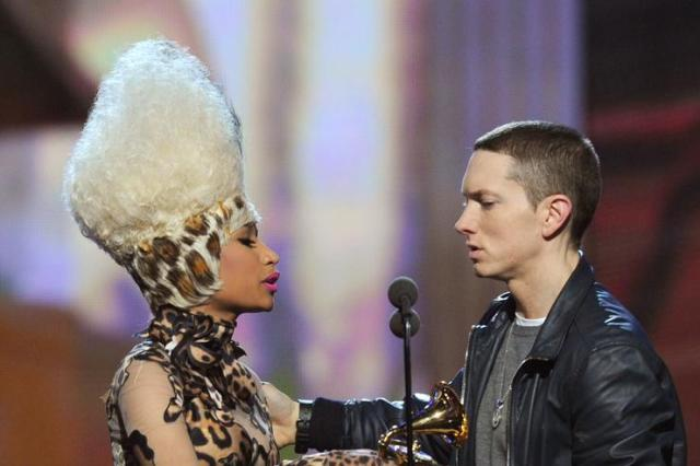 Nicki Minaj (L) presents Eminem the Best Rap Album Award for 'Recovery' onstage during The 53rd Annual GRAMMY Awards held at Staples Center on February 13, 2011 in Los Angeles, California