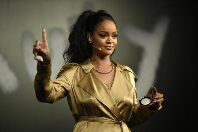 Rihanna gestures on stage during her Fenty Beauty talk in collaboration with Sephora, for the launch of her new Stunna Lip paint 'Uninvited' on September 29, 2018 in Dubai, United Arab Emirates.