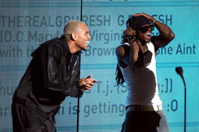 Chris Brown and rapper Lil Wayne accept the Best Collaboration award onstage during the BET Awards '11 held at the Shrine Auditorium on June 26, 2011 in Los Angeles, California