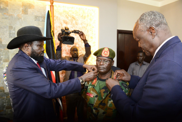 President Kiir and his minister of defense forces, Gen. Kuol Manyang Juuk, promotes Lt. Gen. Gabriel Jok Riak to rank of General before appointing him the new chief of staff despites international sanctions(Photo credit: supplied)
