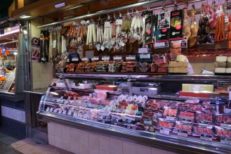 one of many butcher shops at the market