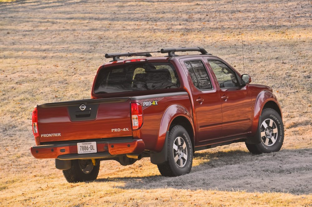 medium resolution of 2014 nissan frontier crew cab three quarters back view