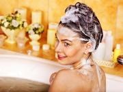 woman washing hair in bath. stock