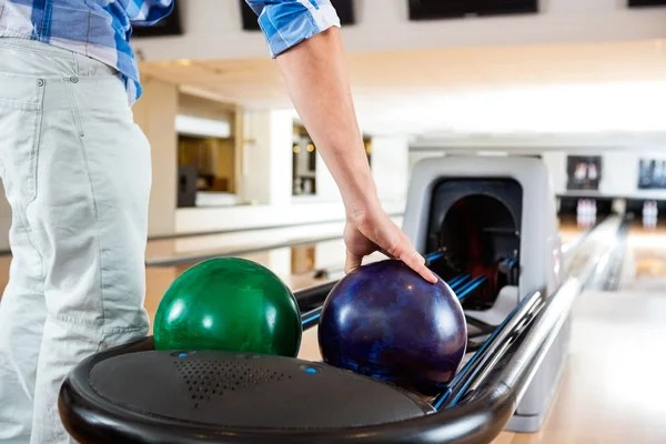 man s hand picking up bowling ball from rack stock images page everypixel