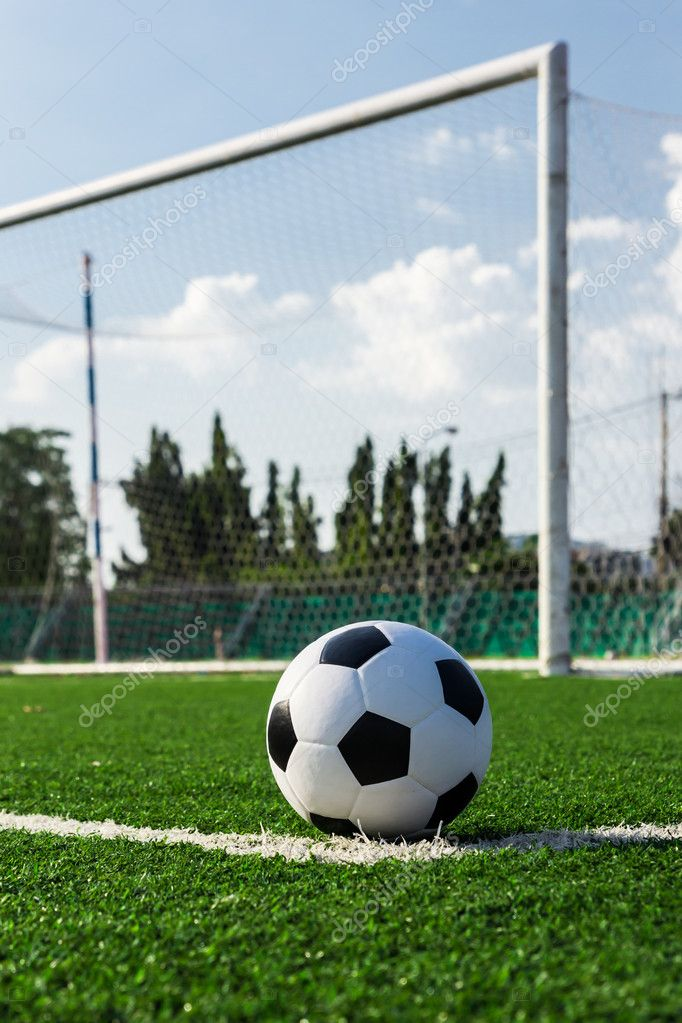 soccer ball on grass stock photography