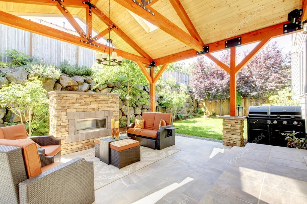 exterior covered patio with fireplace and furniture stock photo image by c iriana88w 19913163