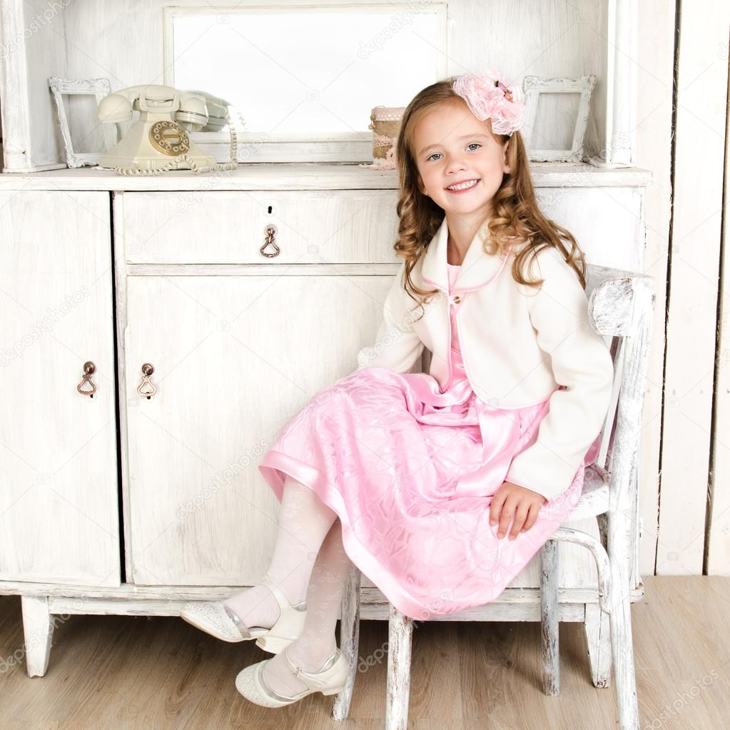 little girl chairs tufted corner chair adorable sitting on stock photo c svetamart in vintage interior by
