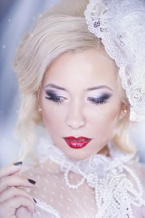 winter woman portrait snow beauty fashion model girl with white hair and blue eyes closeup
