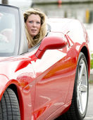 Sexy woman in red sports car — Stockfoto #13071694