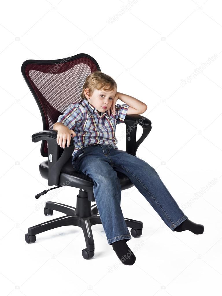 Tired little boy sitting on chair  Stock Photo  kozzi2