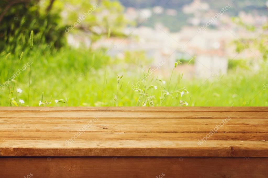 Empty wooden table over bokeh natural background  Stock