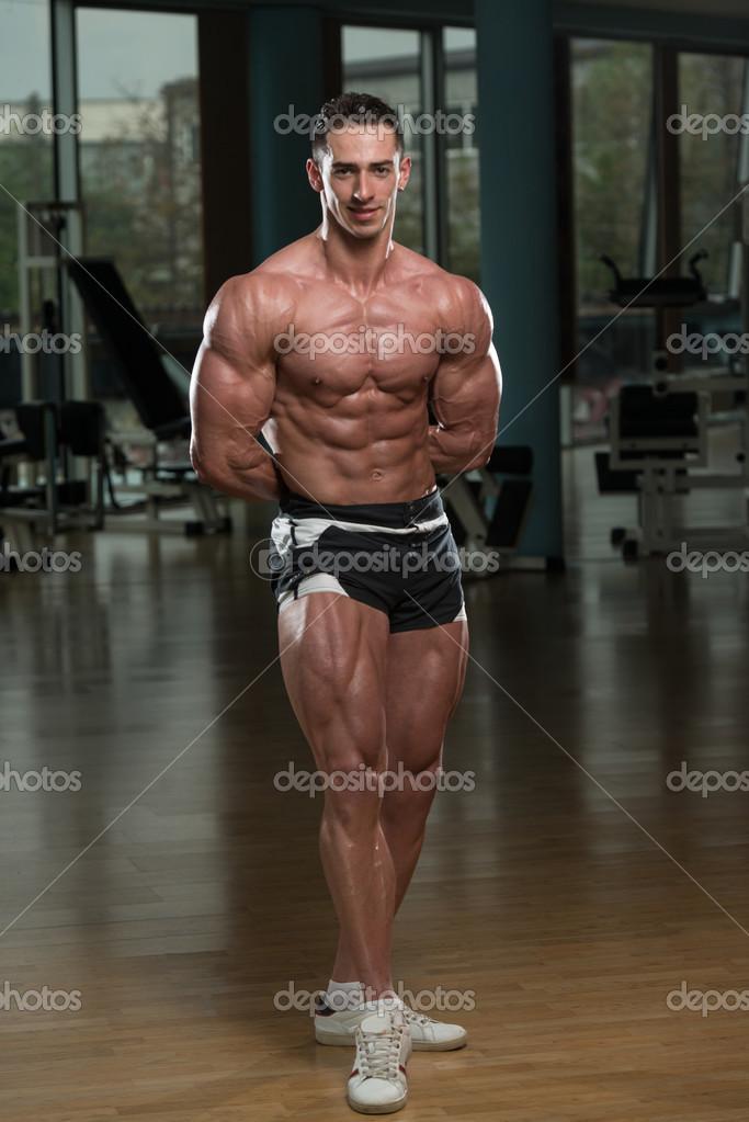 muscular men flexing muscles