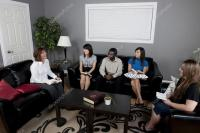Group Of People Talking In A Living Room  Stock Photo
