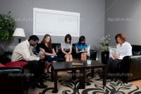 Group Of People Talking In A Living Room  Stock Photo ...