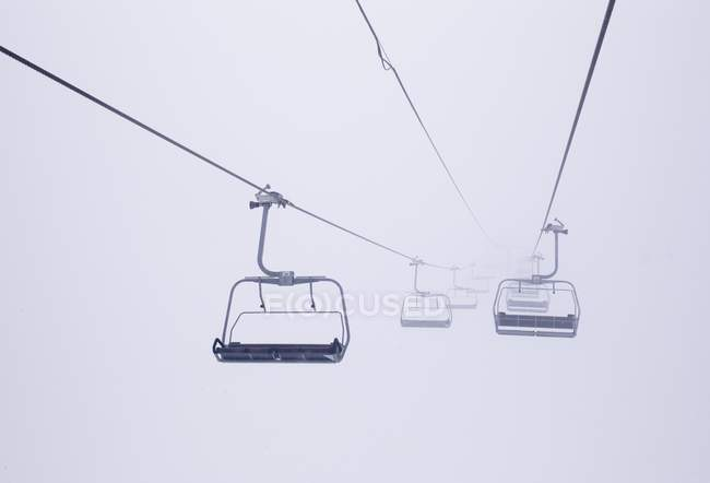 buy ski lift chair white leather armless desk chairs in the fog distant view copy space low angle stock photo
