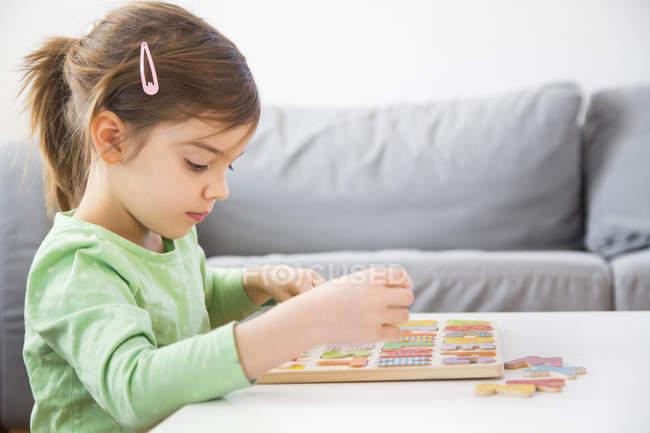 little girl learning alphabet