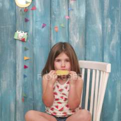 Little Girl Chairs Academy Sports Sitting On Chair Eating Lemon Ice Lolly Color Image Brown Hair Stock Photo 173590864