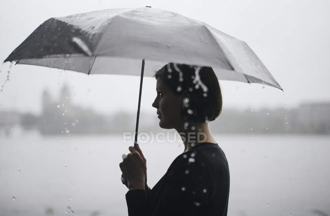 woman with umbrella on