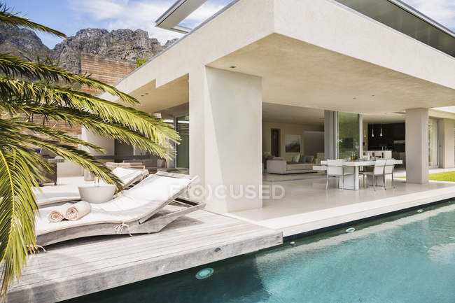 swimming pool and patio of modern house
