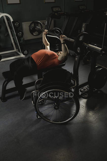 gym chest chair halloween covers dollar tree handicapped man doing workout on bench press with barbell in one person young stock photo 208506926