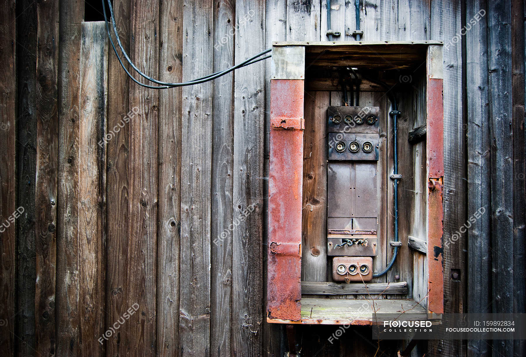 hight resolution of wooden planks on wall of old house and fuse box stock photos