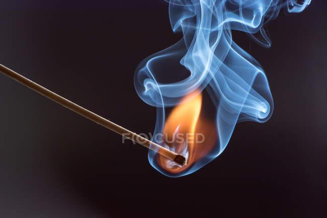 burning match stick with