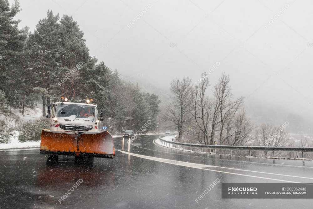 medium resolution of snow plow removing snow during blizzard stock photos