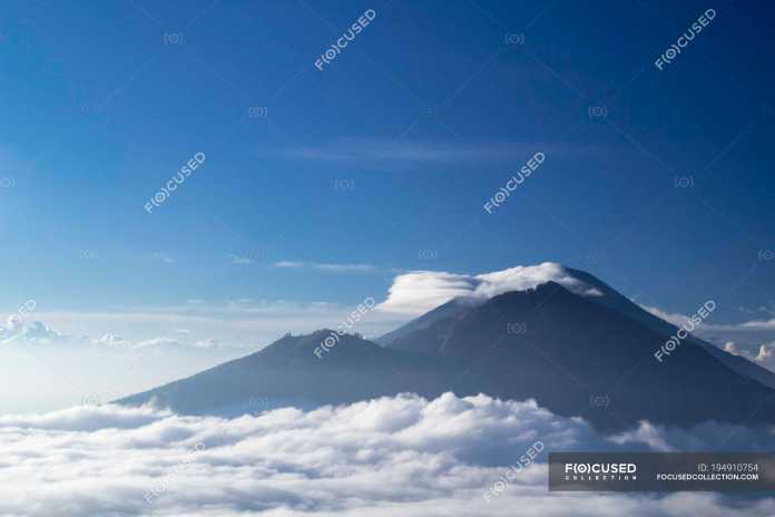 Indonesia Bali Abang And Agung Volcanoes In Clouds Tourism Landscape Stock Photo 194910754