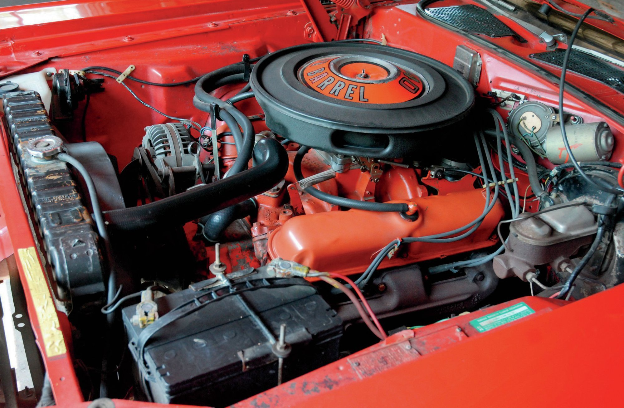 hight resolution of the challenger s engine compartment still holds the original 340ci small block it is backed