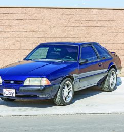 the dark blue car s 1997 1998 mustang five lug rims clear larger 2000 [ 2040 x 1360 Pixel ]