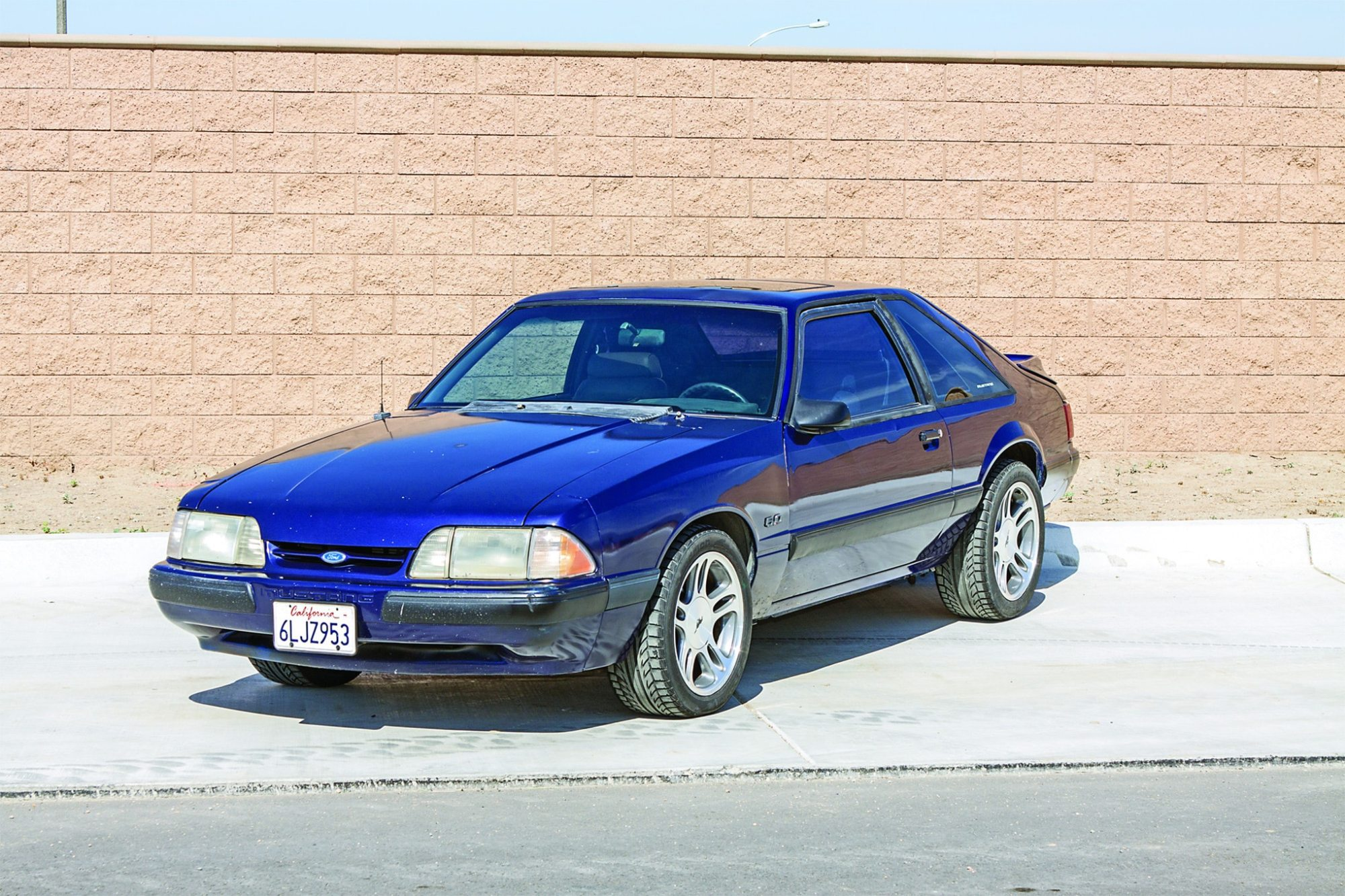 hight resolution of the dark blue car s 1997 1998 mustang five lug rims clear larger 2000