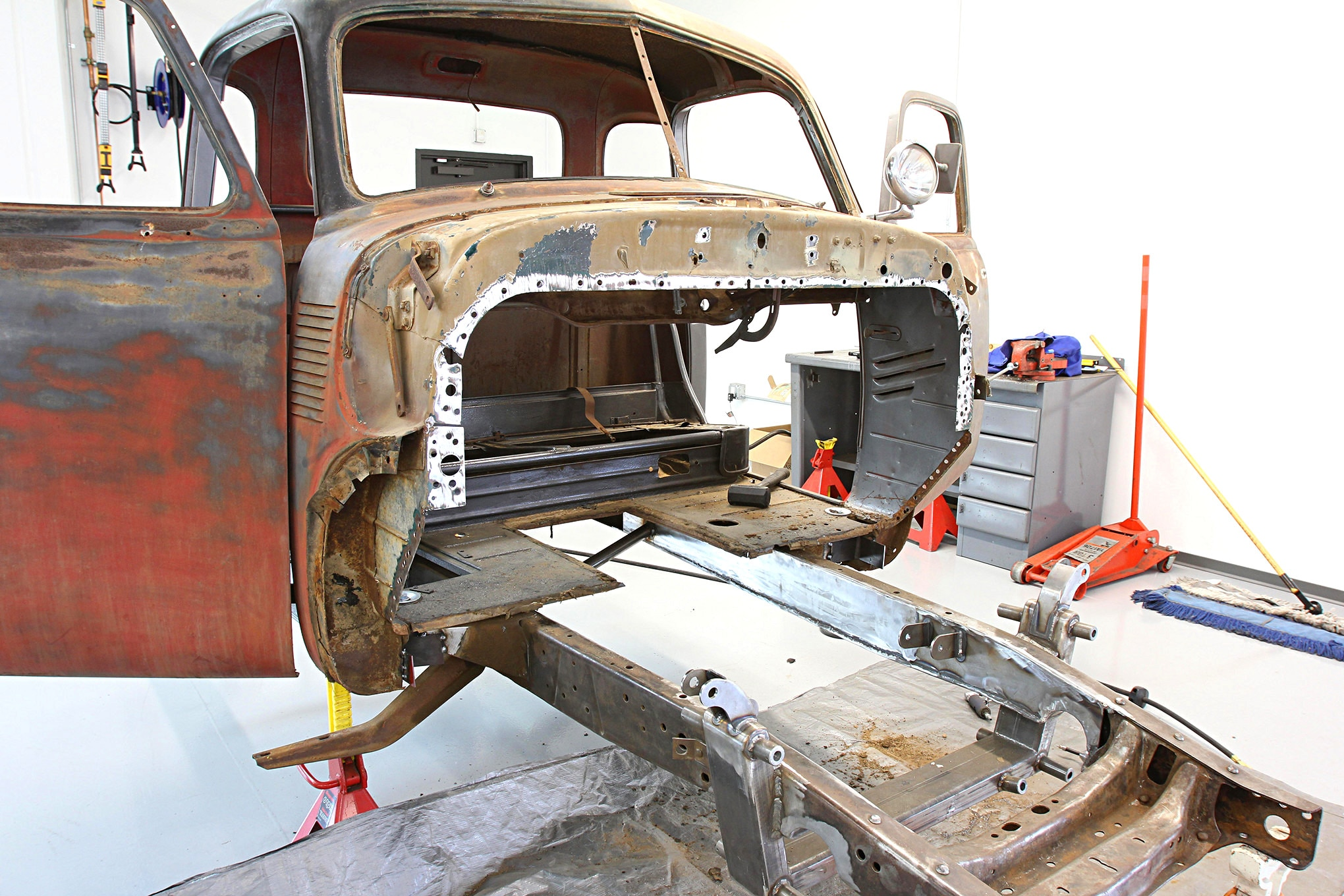 Repairing a damaged floor and firewall on a Chevy truck