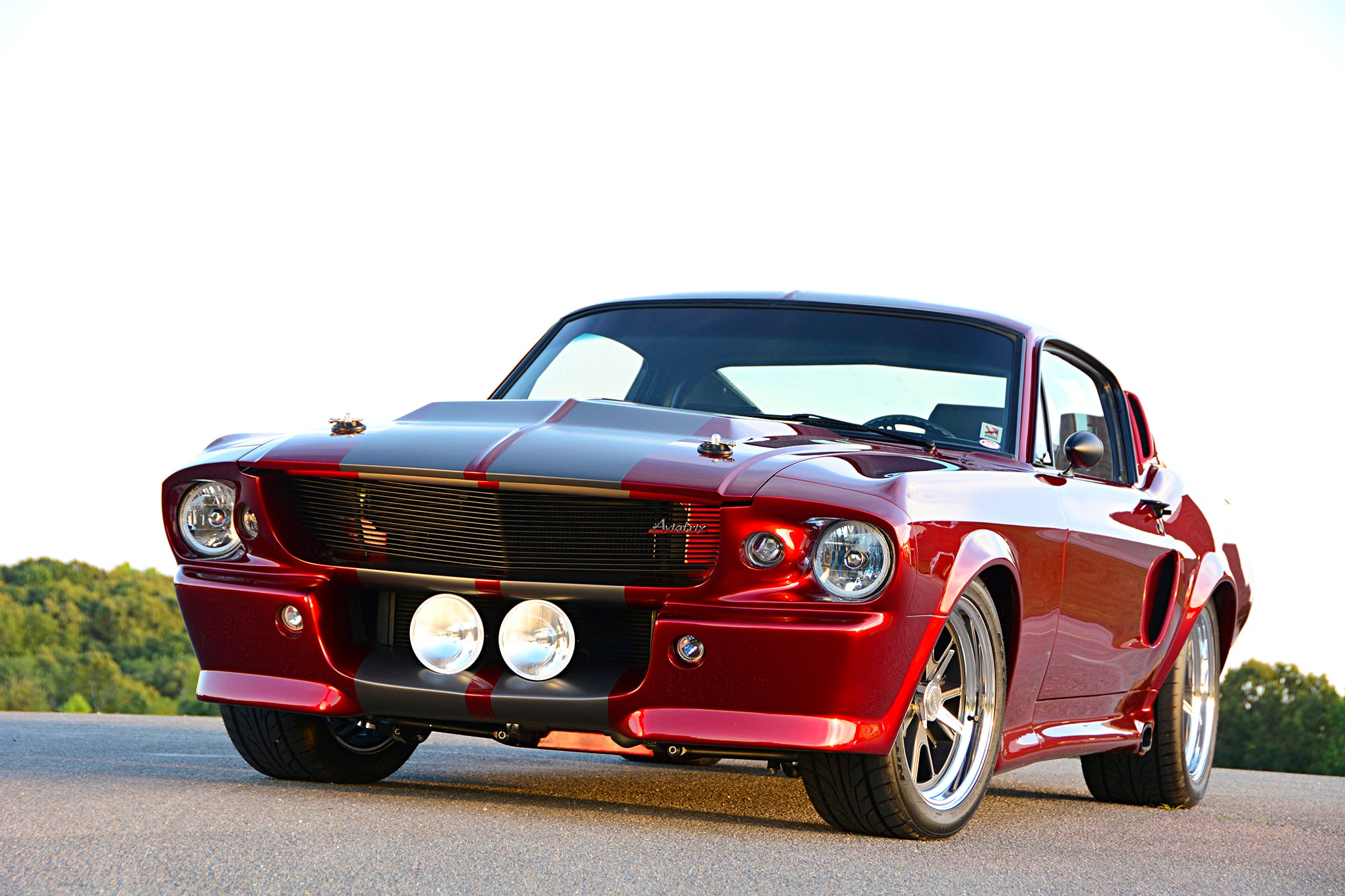 Slathered in candy-apple-red paint, this 1967 Mustang body is modified from front to back, but it still retains the classic Eleanor styling that Amy wanted. B Rod or Custom handled the build and scratch-built the fenders, hood, and many other body panels from fiberglass.