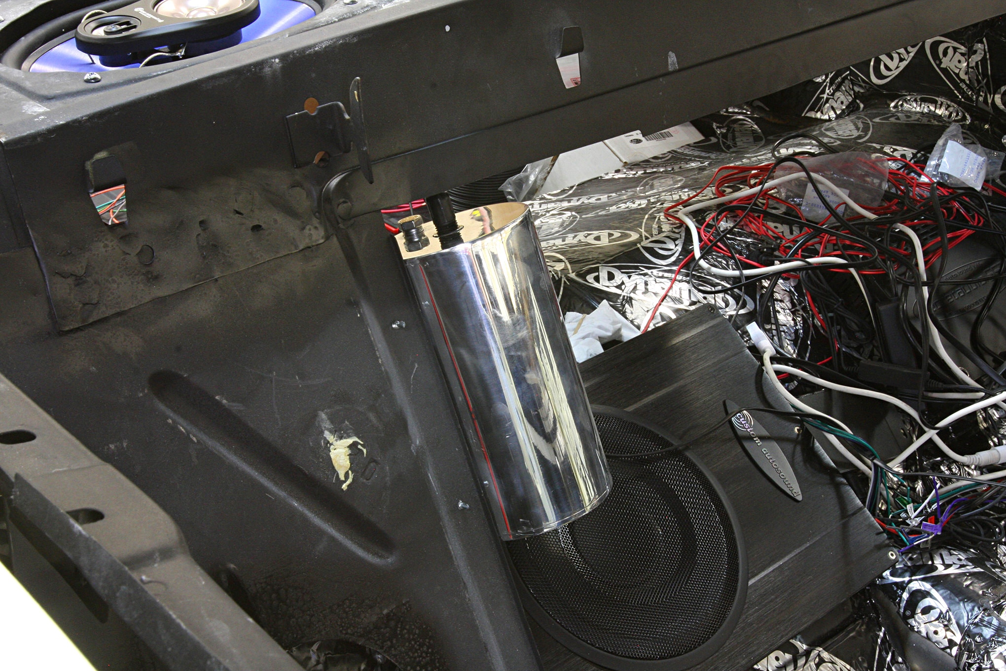 To prevent the odor associated with a vented gas tank HRBD installed one of their evaporative control canisters in the trunk.