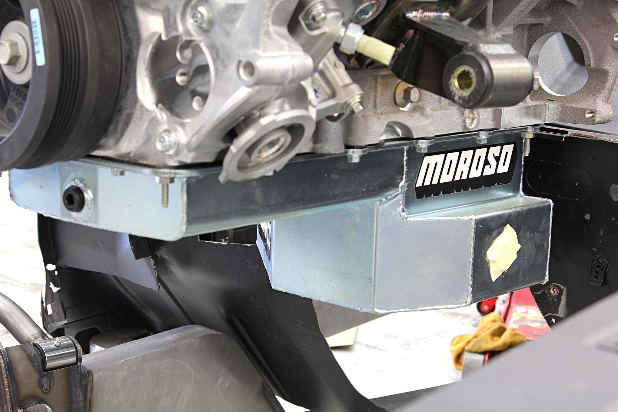 To get the engine as low as possible and maintain adequate crossmember and rack-and-pinion steering clearance the stock pan and oil pump pickup were swapped for Moroso parts.