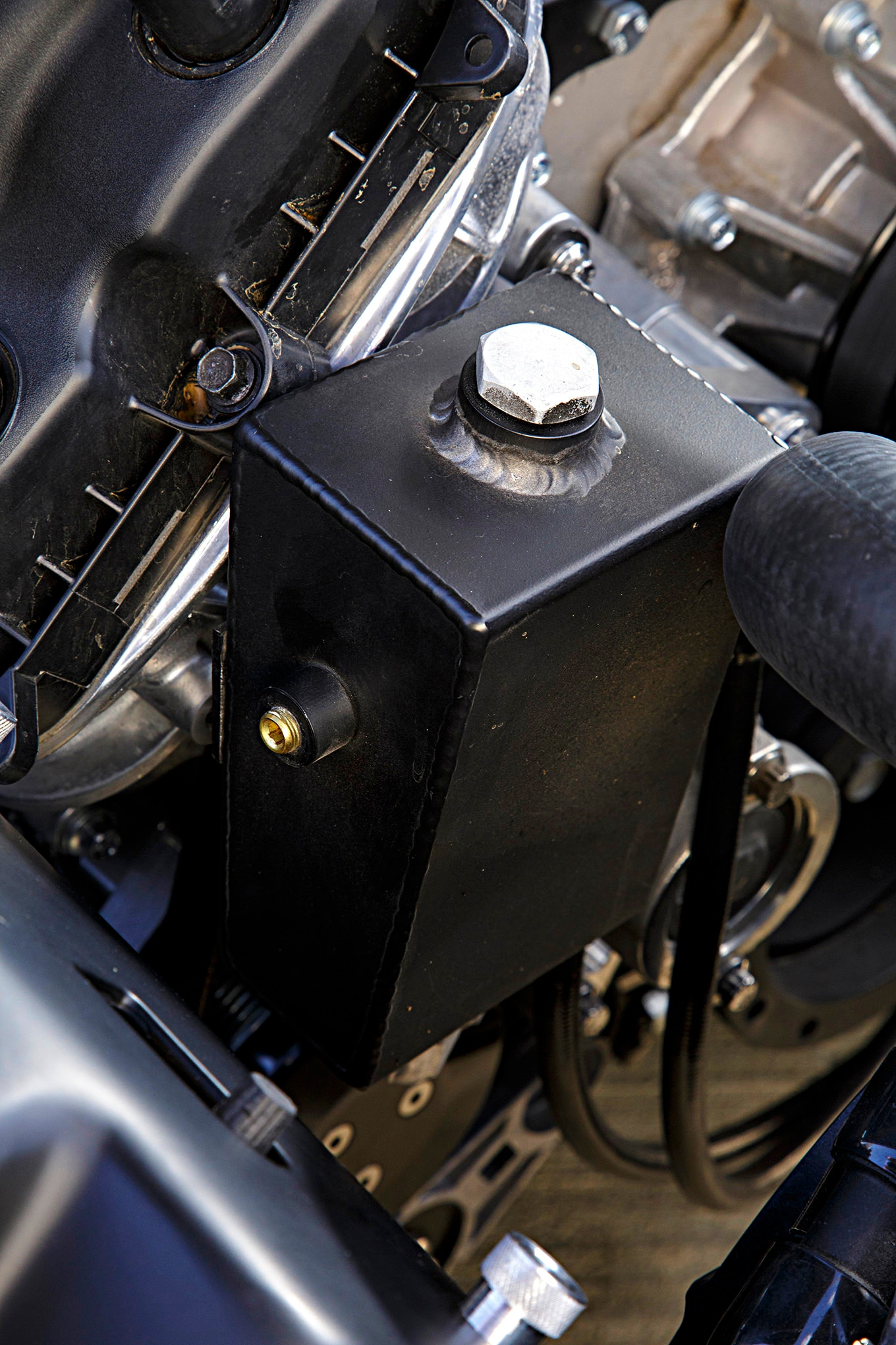 Speedway Motors supplied the power steering reservoir. It's mounted in front of the right head.