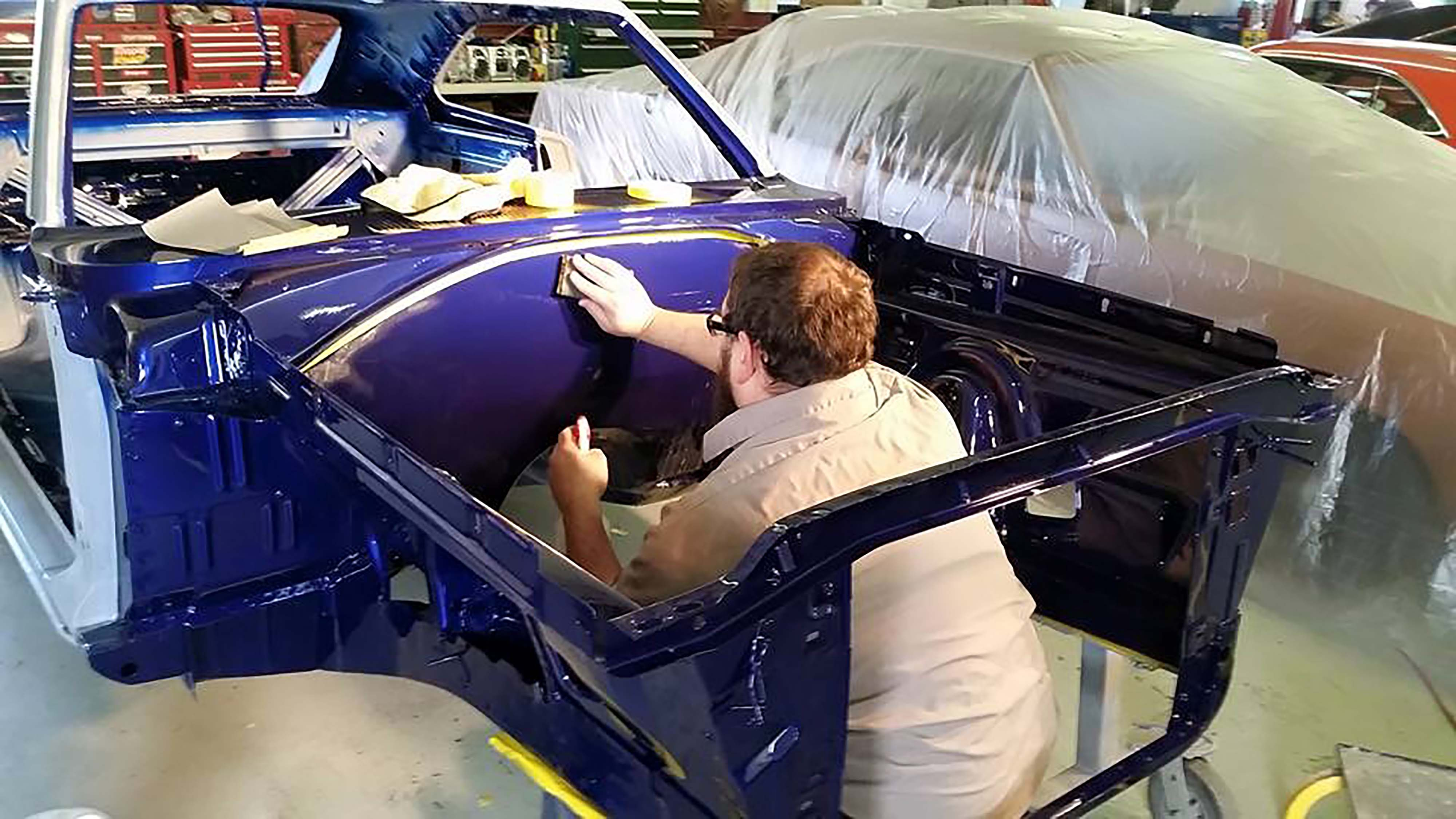 Scott Dowdy, who did all of the body work on the car, got into the action too, helping Webb by sanding and buffing the smoothed-out firewall.