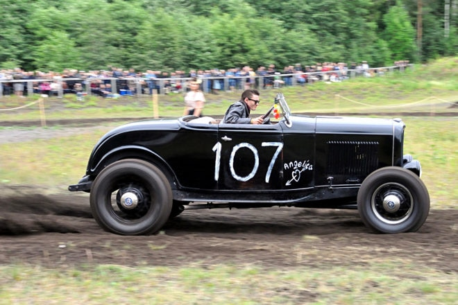 Gunning It: A-Bombers Mike Johansson was one of the favorites on the dirt track with his '32 roadster. The roadster bounced around in the corners so much, Mike nearly fell out of the seat.