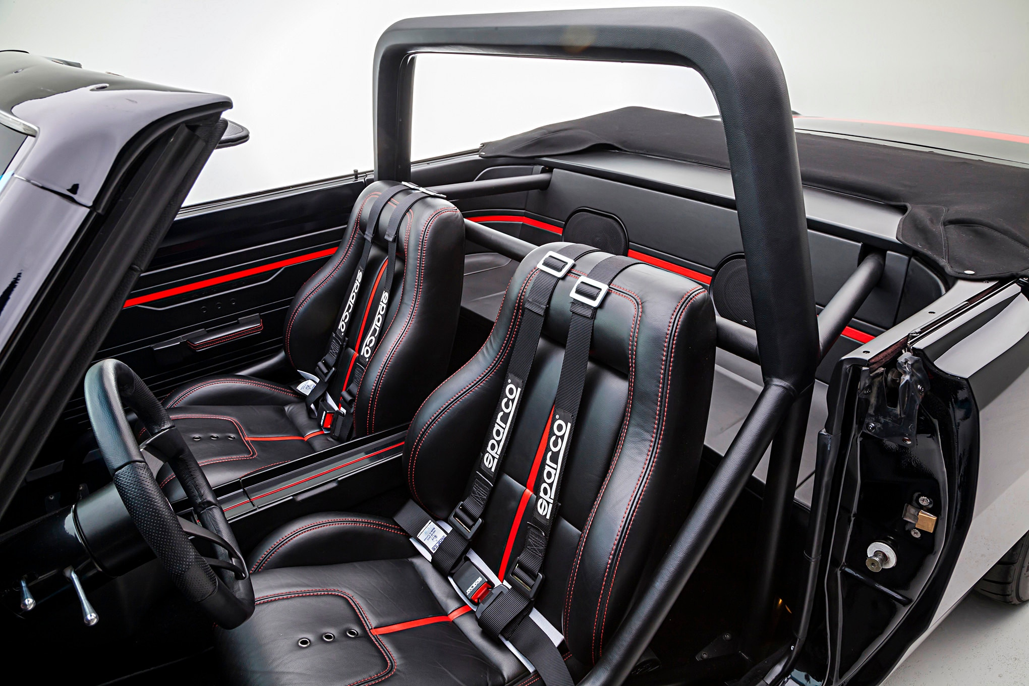 The rear seats are gone and the area is now taken up by part of the roll cage and speakers for the ARC Audio hi-fi system.