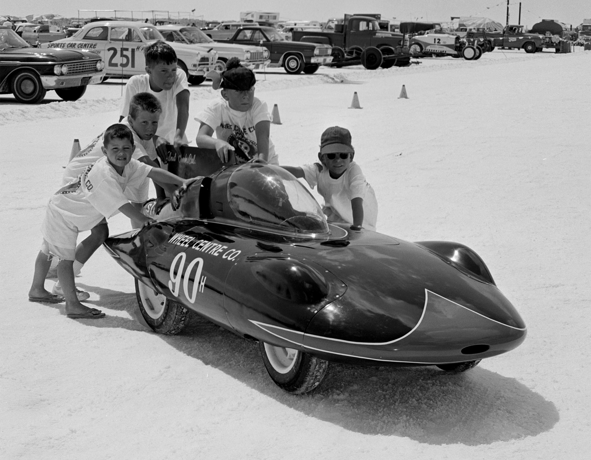 His youthful pit crew pushed Dick Beith off to multiple attempts at the H/Streamliner record of 144.436 mph, but the swoopy minicar's 44ci Mercury outboard engine topped out at 141.50.