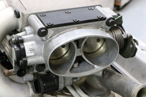 Since we ran both motors with a Holley HP ECU, we swapped out the factory small-cap HEI distributor for an MSD unit.