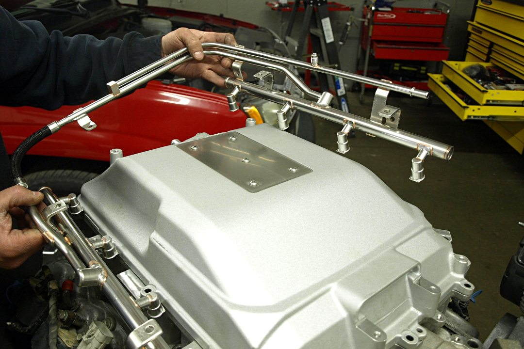 The fuel rail can be obtained from several sources: this one's a Caddy CTS-V unit (PN 12605222). The existing ECM on the host vehicle must be reprogrammed to work with the added supercharger. NextGen offers this service, as do hot rod shops across the nation. For best results, select a shop with a chassis dyno.