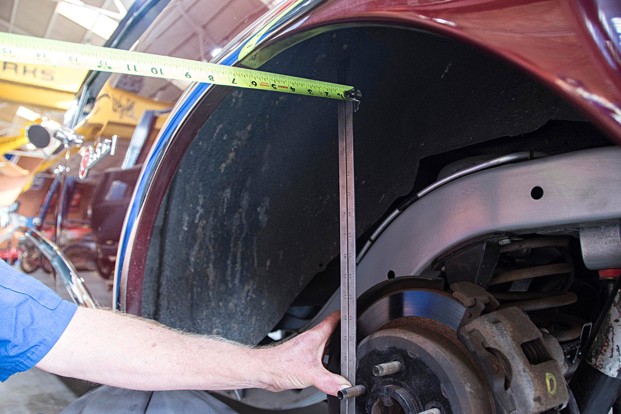 Measuring the rear is pretty straightforward. We start by measuring from the flange to the lip on the quarter-panel. We like to allow 0.5-inch for flex, and our measurement shows 5.5 inches of room from flange to lip.