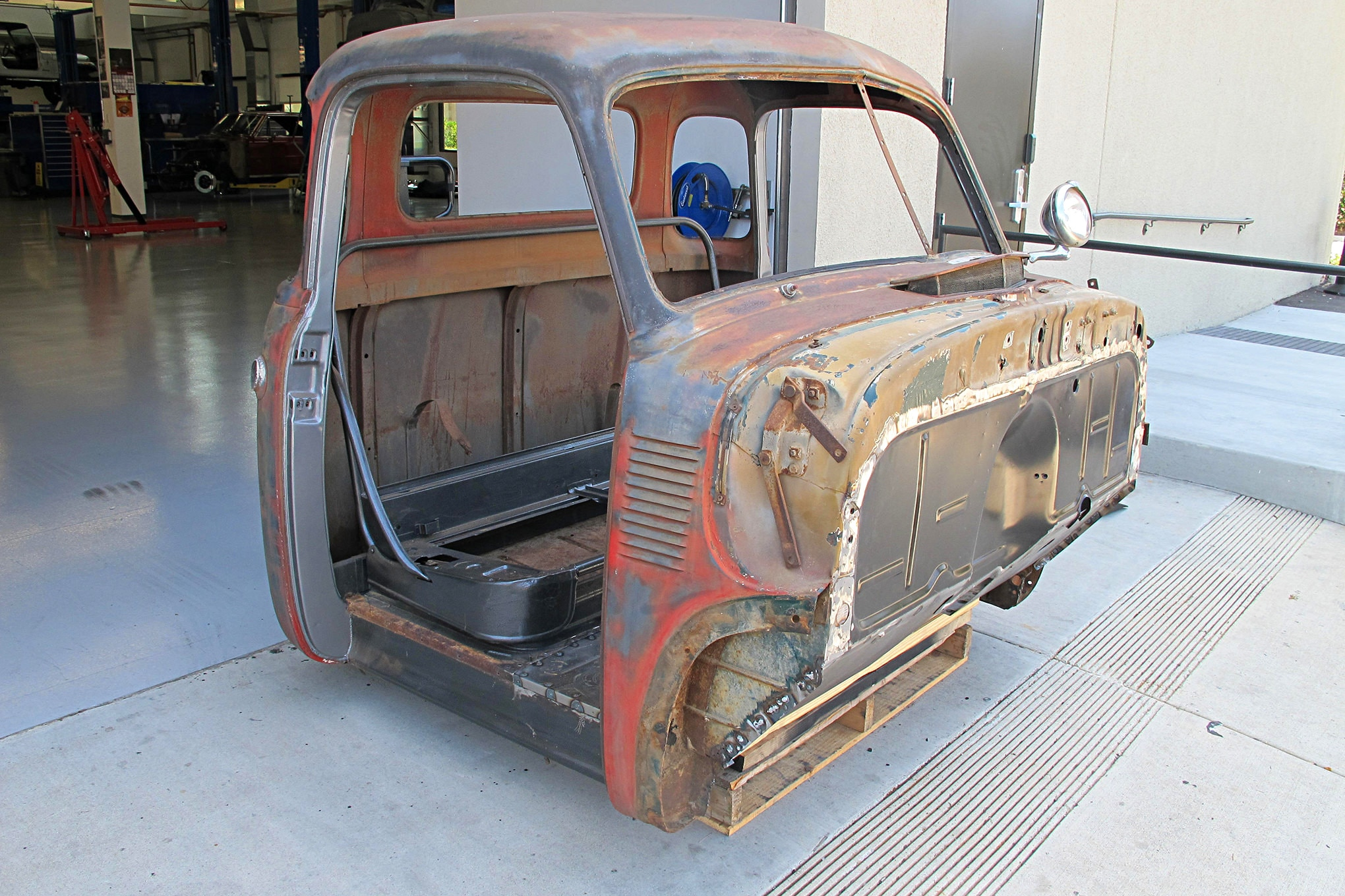 Buck Lyons' 1949 Chevy cab had some rusty sheetmetal replaced with panels from Classic Parts of America. The next task was to protect the rest of it from the elements.
